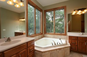 Newly remodeled bathroom with double vanities and jacuzzi style tub.