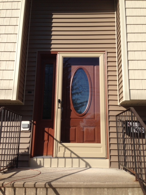 New fiberglass door (stained wood look) with storm door